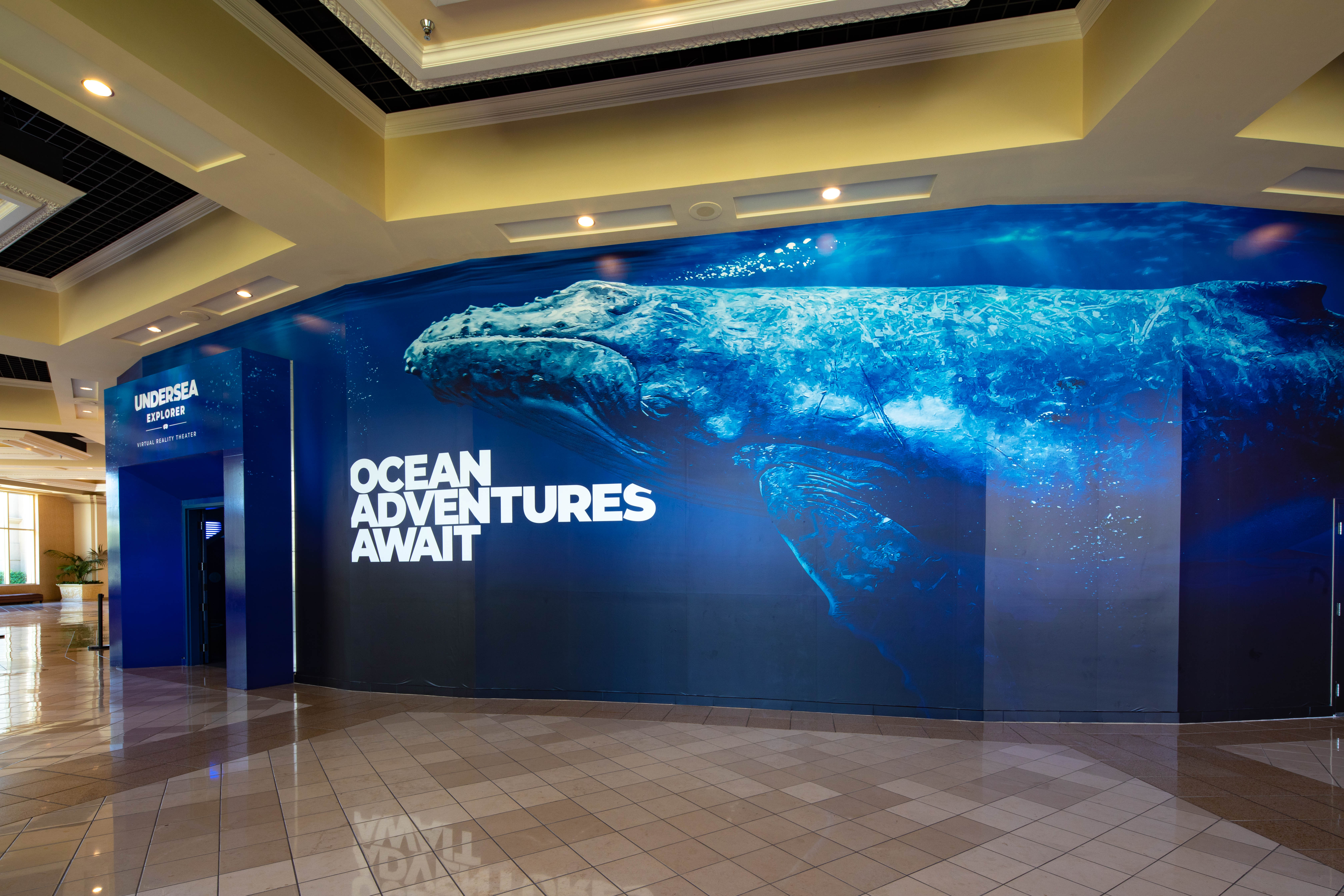 "Immotion's ""Undersea Explorer"" at Mandalay Bay's Shark Reef Aquarium offers virtual encounters with sharks and humpback whales"